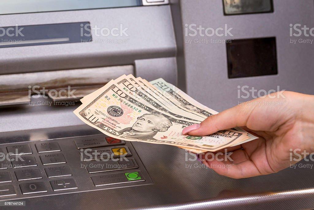 dollar bills from atm stock photo