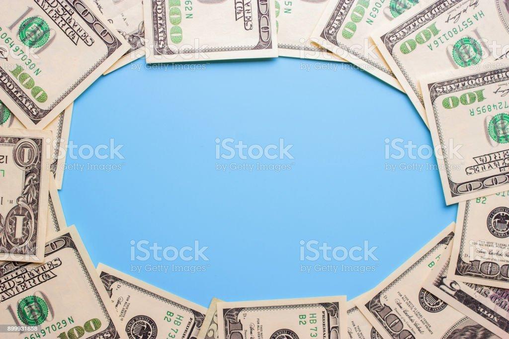 100 dollar bills on the blue background stock photo
