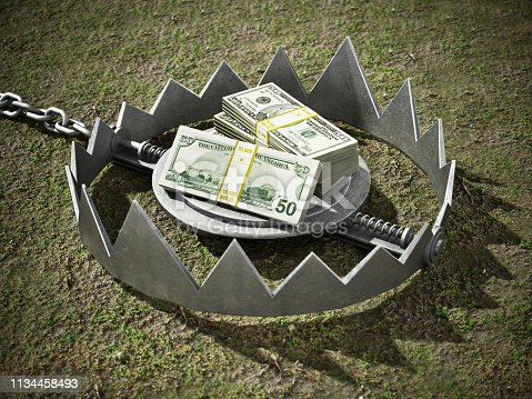 Dollar bills standing at the middle of open bear trap.