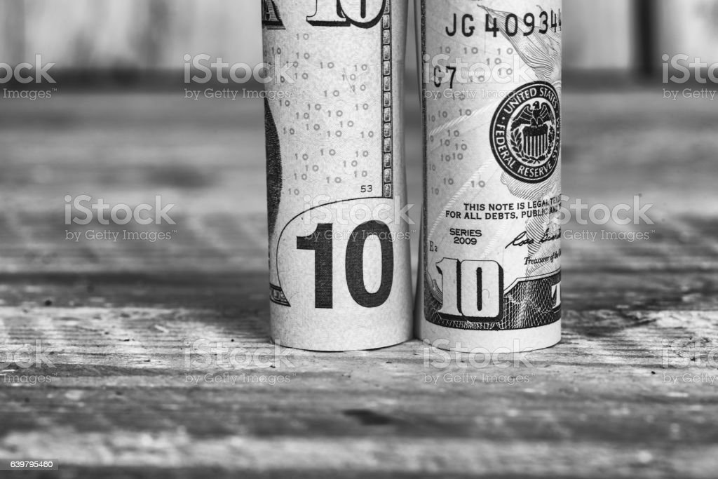 dollar bills tied with rubber band stock photo