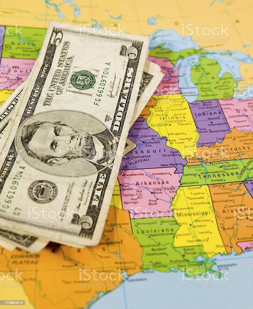 U.S dollar bills with map stock photo