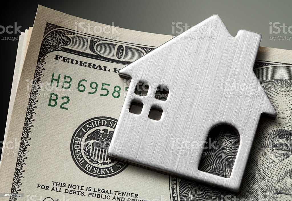 Dollar bills with miniature model house stock photo