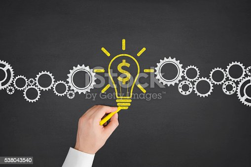 istock Dollar Bulb with Gears Concept on Blackboard 538043540