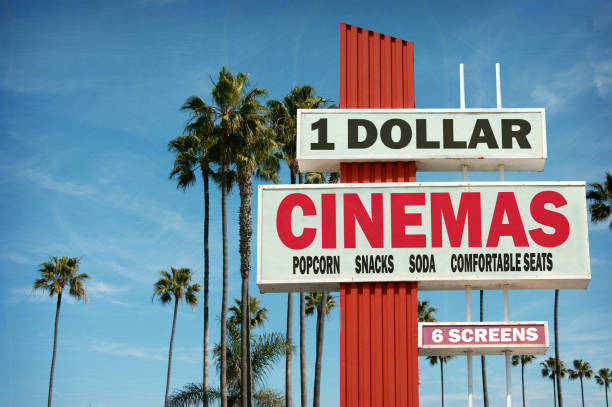 dollar cinema sign aged and worn vintage dollar cinema sign with palm trees theater marquee commercial sign stock pictures, royalty-free photos & images