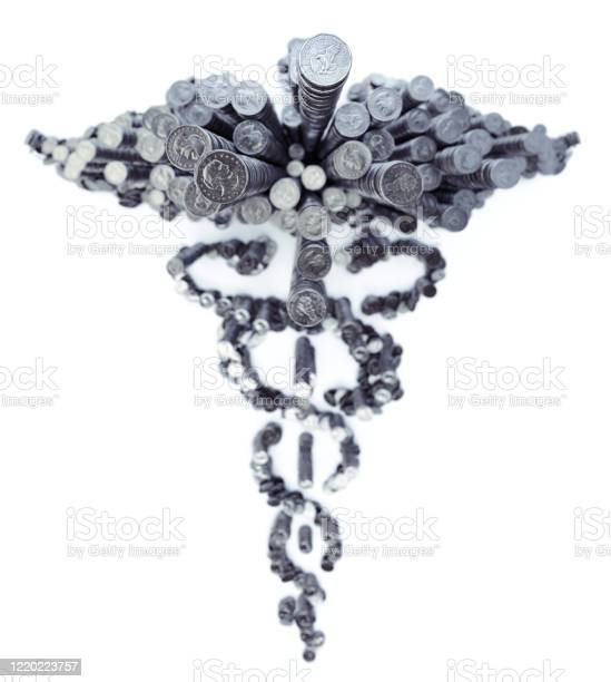 Usd Dollar Coins Forming Healthcare Symbol Stock Photo - Download Image Now