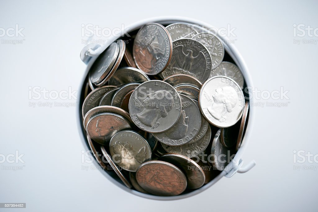 US dollar coins in the bucket stock photo