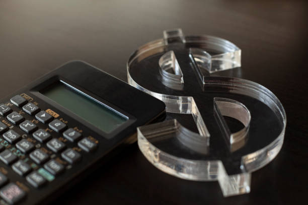 US Dollar currency icon with calculator stock photo