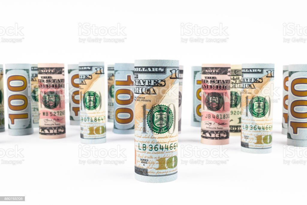 Dollar. Dollar banknotes roll in other positions. American US currency on white board. American dollar banknote rolls in all denominations on white background stock photo