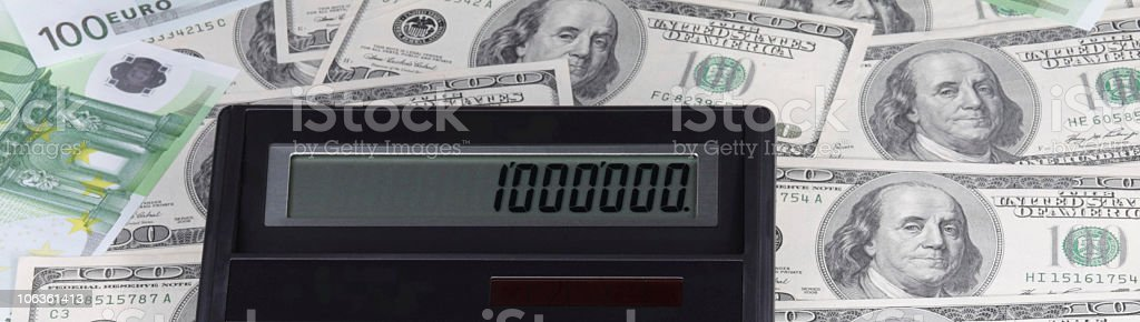 dollar, euro banknote and calculator  American Culture Stock Photo