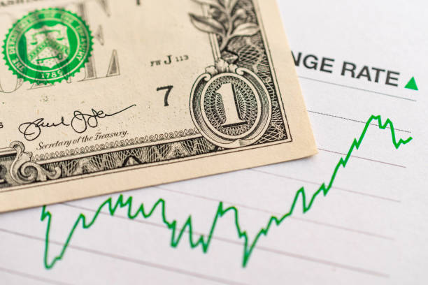 us dollar exchange rate: 1 us dollar bill placed on a green graph showing increase in currency exchange rate - rates stock photos and pictures