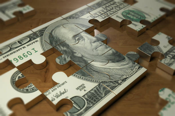 Dollar finance concept - Stock image Dollar puzzle piece on the wood table. finance and business industry us paper currency stock pictures, royalty-free photos & images