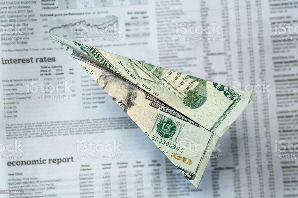 Dollar Flight—Twenty Note Bill Paper Airplane Over Financial Data stock photo