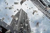 istock Dollar Flying in City 1018751554