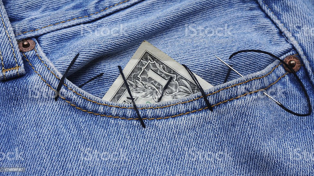 dollar in the pocket dollar bill sewn in the jeans pocket Bank - Financial Building Stock Photo