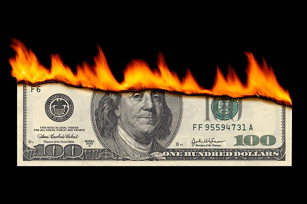 Dollar Note Burning Dollar note burning. money to burn stock pictures, royalty-free photos & images