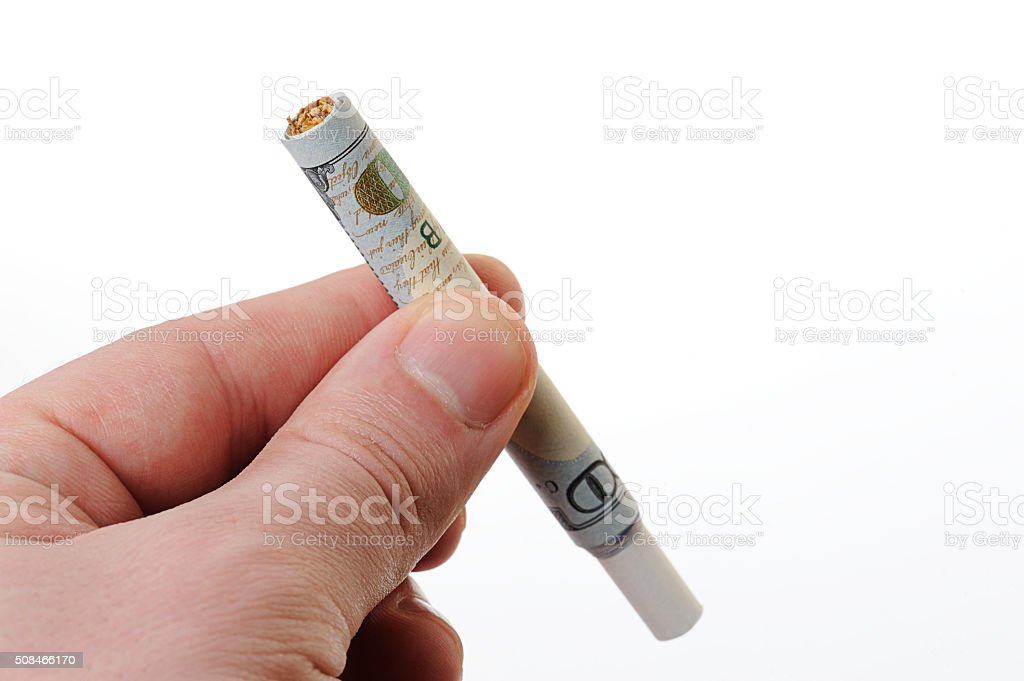 dollar rolled as cigarette stock photo