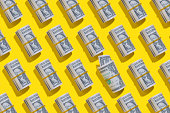 Repetitive American one dollar banknote rolls flat lay on yellow background
