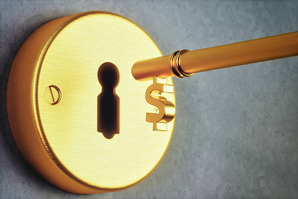 dollar shaped key and keyhole - computertaste stock-fotos und bilder