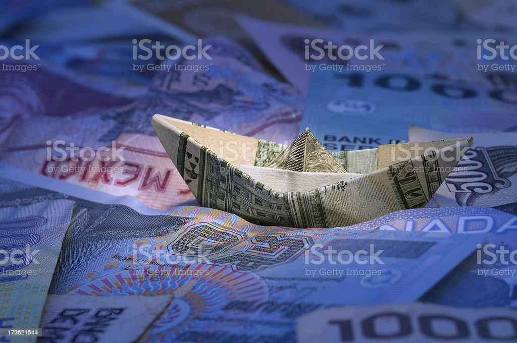 Dollar ship floating in money sea stock photo