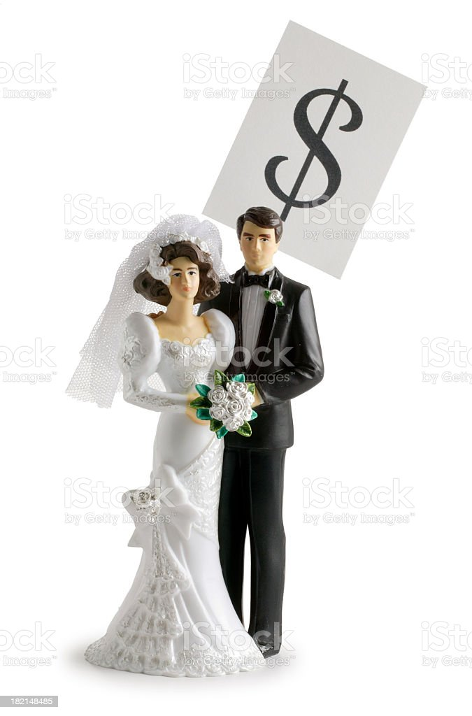 Dollar sign and a wedding cake topper royalty-free stock photo