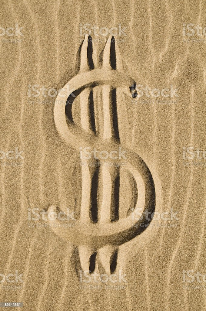 Dollar sign in the sand royalty-free stock photo
