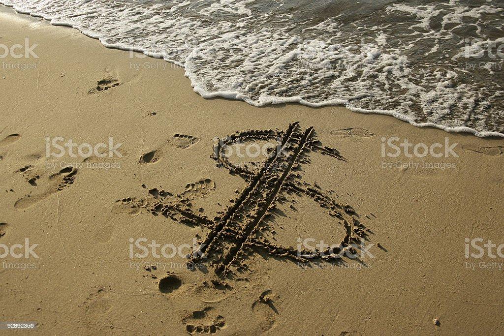 dollar sign on beach stock photo