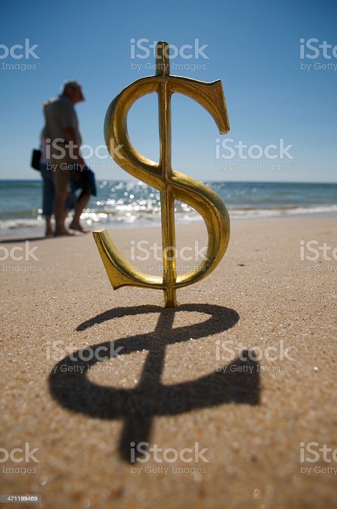 Dollar Sign on the Beach with Couple royalty-free stock photo