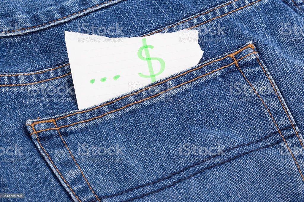 dollar sign paper in jean pocket
