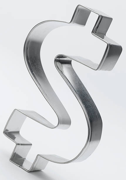 Dollar Sign A shiny metal dollar sign. cookie cutter stock pictures, royalty-free photos & images