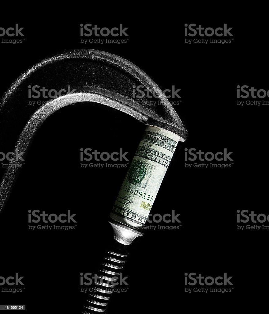 Dollar squeeze stock photo