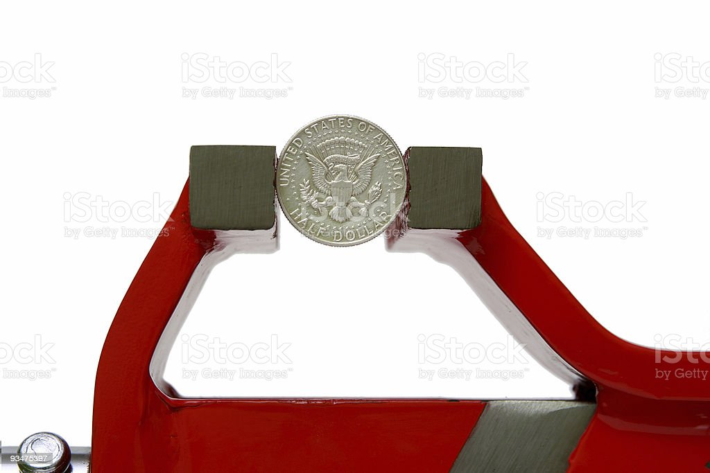 Dollar squeezed in a vise royalty-free stock photo