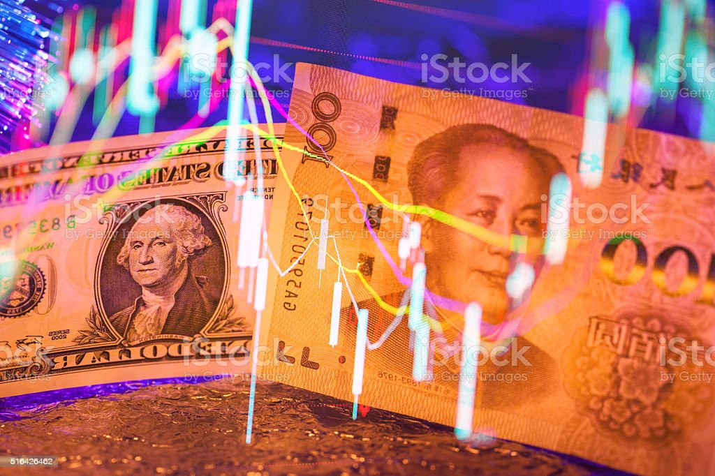US dollar with chinese yuan background under light stock photo