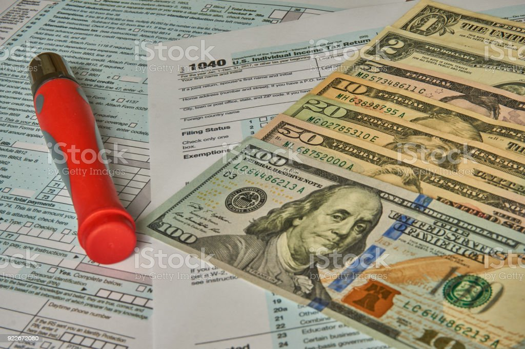 Dollars and 1040 income form stock photo