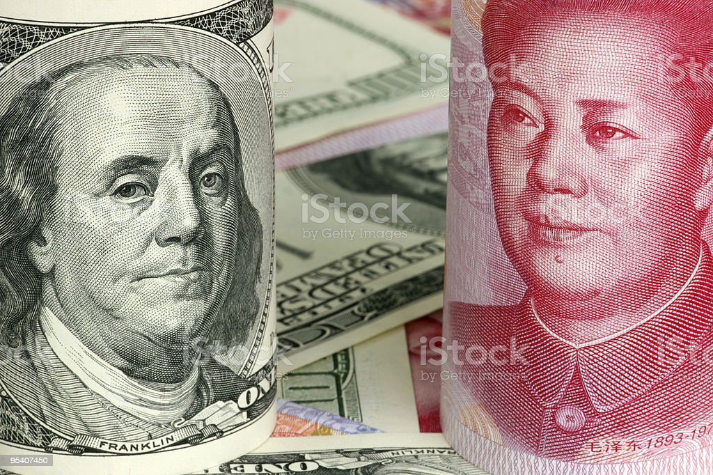 US Dollars and Chinese Yuan royalty-free stock photo
