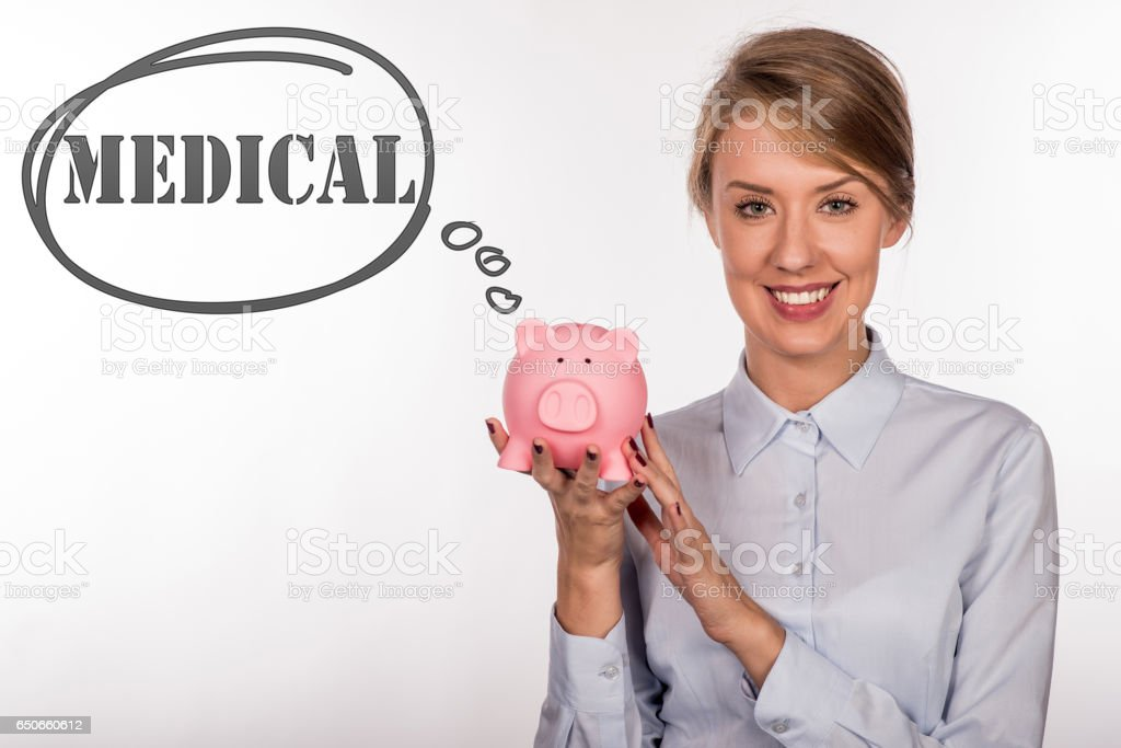 Dollars and coins in piggy bank for medical expenses. stock photo