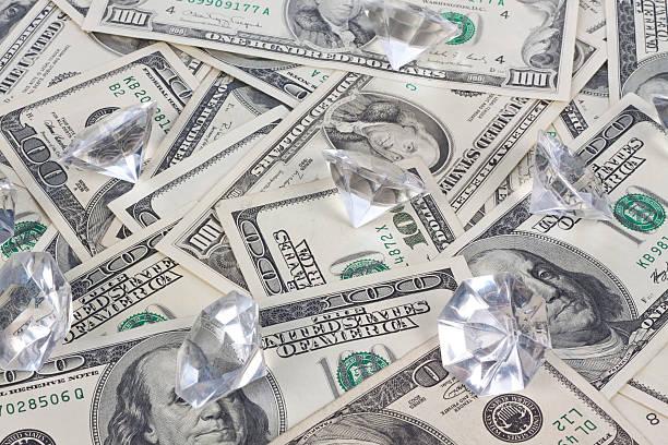 dollar und diamanten - diamanten kaufen stock-fotos und bilder
