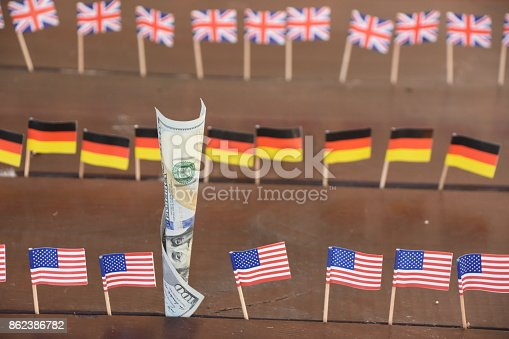 istock 100 dollars and flags of the world 862386782