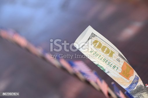 istock 100 dollars and flags of the world 862392824