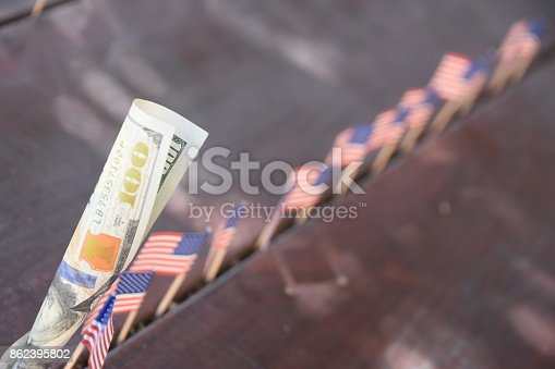 istock 100 dollars and flags of the world 862395802