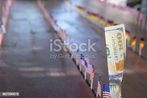 istock 100 dollars and flags of the world 862396678