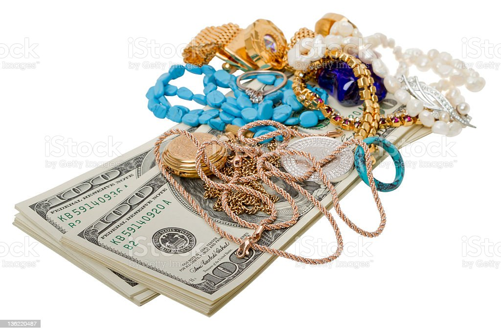 Dollars and jewelry royalty-free stock photo