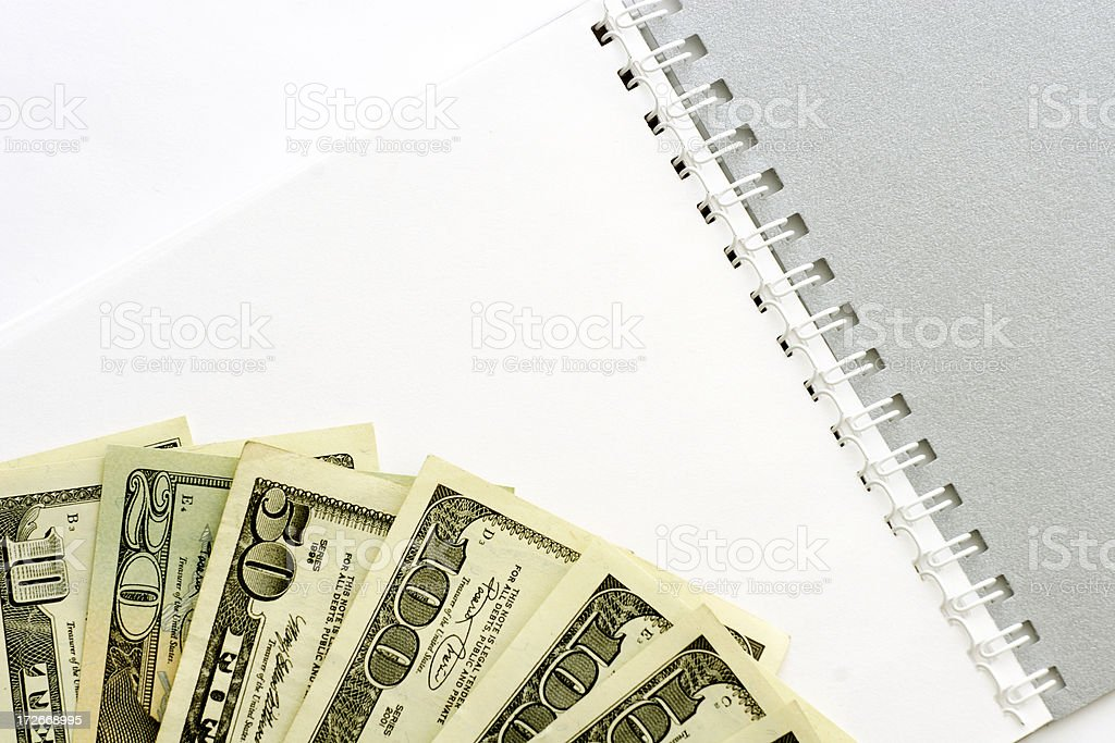 Dollars and notebook royalty-free stock photo