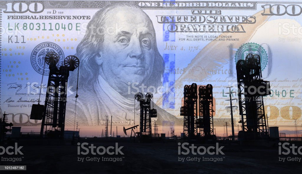 Dollars and oil pumps royalty-free stock photo