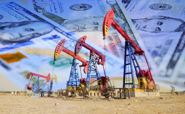 Dollars and oil pumps stock photo