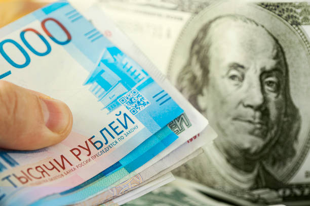 dollars and rubles. concept of currency exchange. Economic crisis, decline of the world economy. Ruble devaluation. The fall of the Russian currency. Currency exchange at the Bank. stock photo