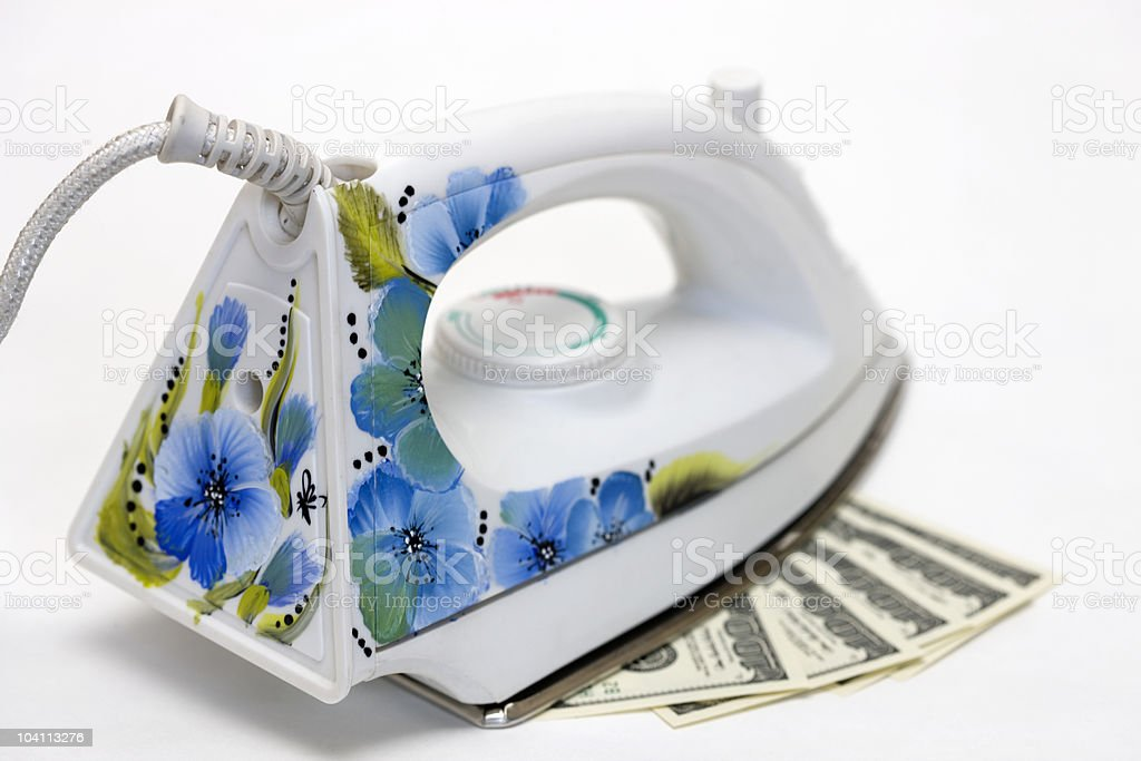 Dollars and Smoothing-iron with stock photo