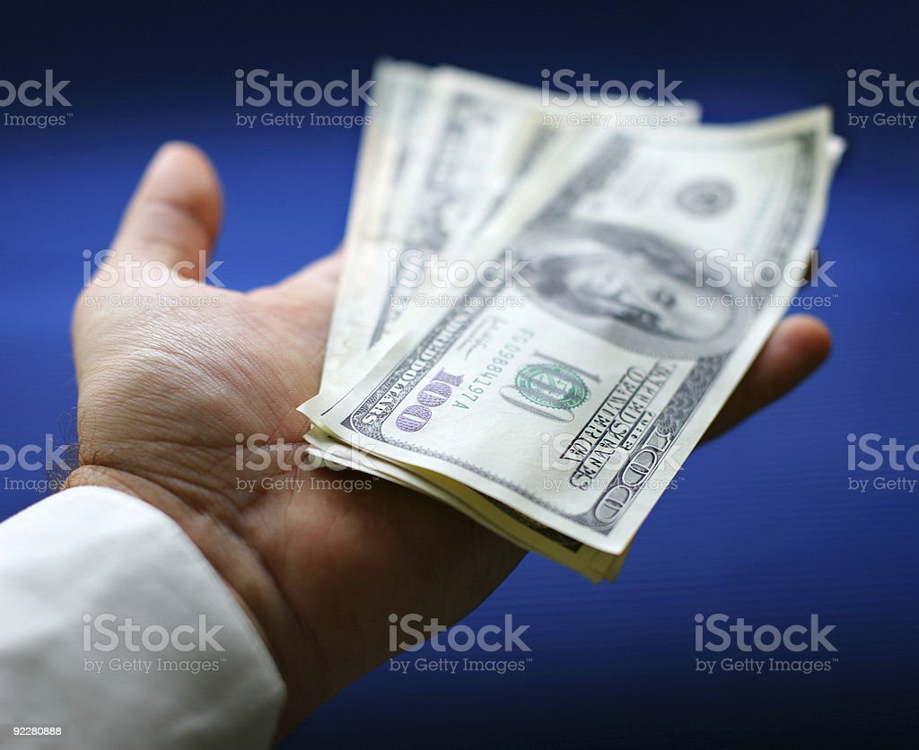 Dollars are in a hand royalty-free stock photo