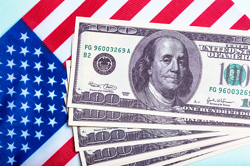 USA dollars background. American rescue plan, USA relief program, stimulus check and Act of 2021 concept. Money, business, profit and livelihood idea. High quality photo