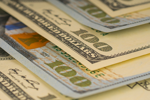 693363558 istock photo 100 dollars, background with paper money 1044241548