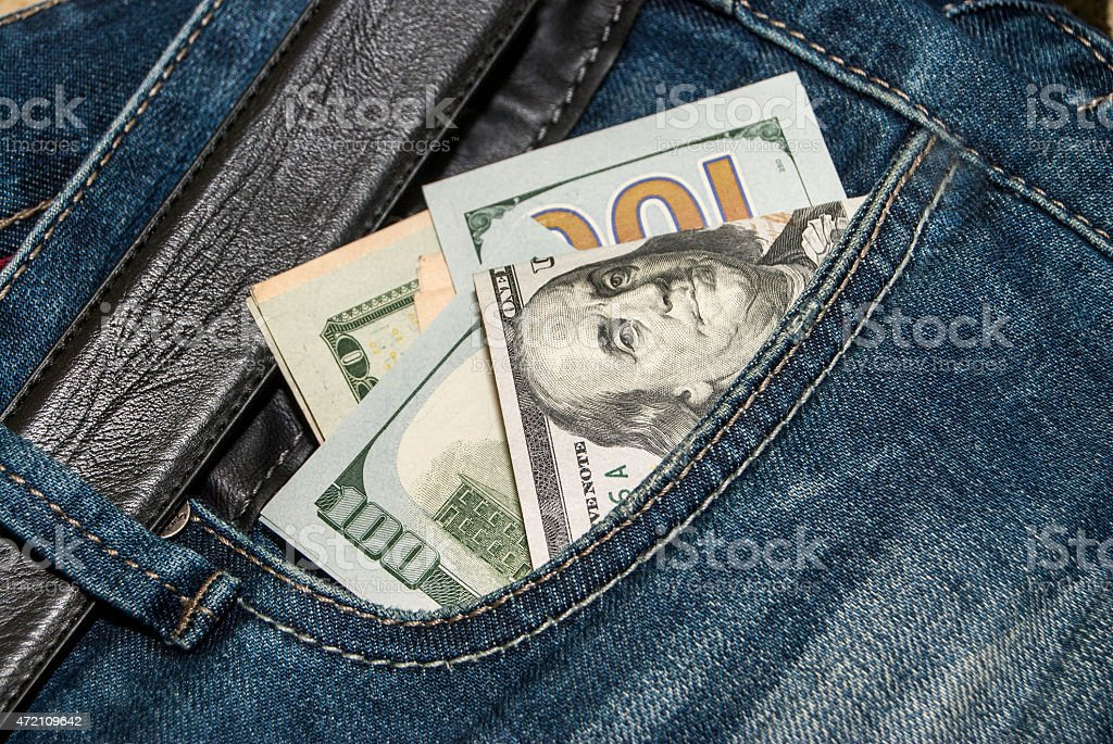 100 dollars banknote in the back jeans pocket stock photo